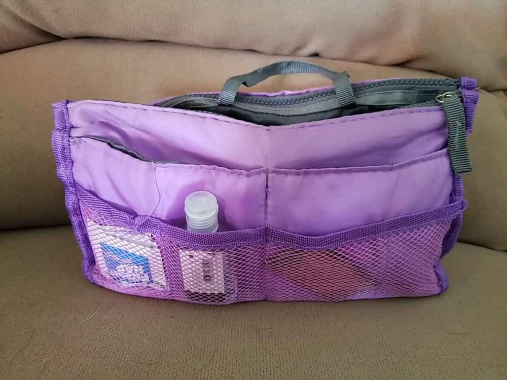 A purple purse organizer with mesh outer pockets