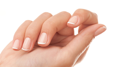 female hand with french manicure