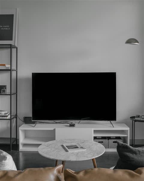 A flat screen tv sitting in a living room