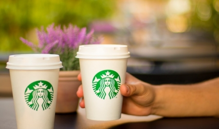 A close up of a coffee cup, with Starbucks