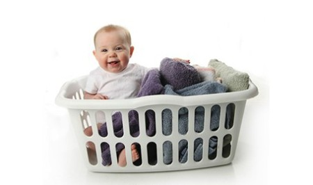 A baby sitting in a basket