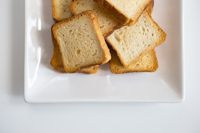 Picture of several smaller pieces of toast on a white plate