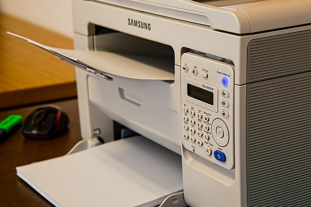 printer with plain white paper loaded in upper and lower trays
