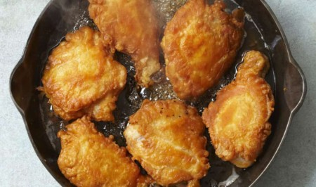 A pan filled with food, with Fried chicken