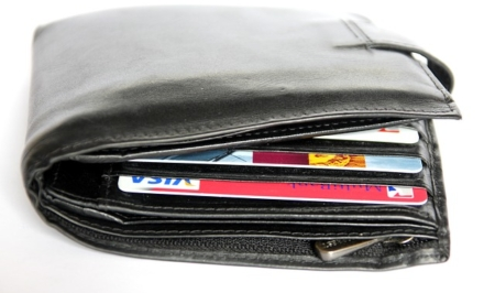 picture of a bulging wallet with credit cards sticking out a tiny bit